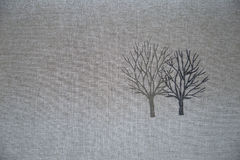 Bare or leafless tree. Two leafless tree on textile Stock Images