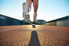 Bare legged jogger bounds towards apartments Royalty Free Stock Photography