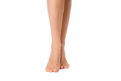 Bare legs of woman isolated on white. Beautiful skin. Foot care Royalty Free Stock Photo