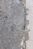 Bare raw concrete wall texture useful as background Stock Photo