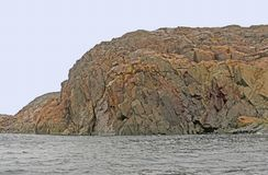 Bare Rock on a Remote Arctic Island. Bare Rock on the Lower Savage Islands near Baffin Island in Nunavut in the arctic area of Canada Stock Photography