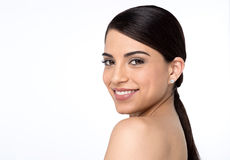 Bare shoulder woman looking into camera Stock Images