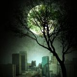 Bare tree with full moon and vintage city skyline. Urban scene Stock Image