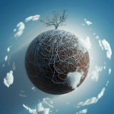 Bare tree on small planet Stock Photo