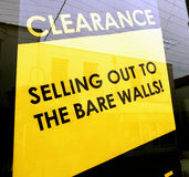 Bare wall sellout. Shop window clearance selling out to bare walls yellow sign Royalty Free Stock Photography