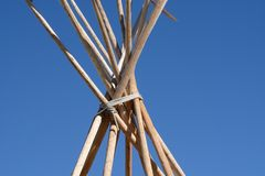 Bare winter teepee poles royalty free stock photo