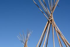 Bare winter teepee or tipi poles at end of camping season. Detail of bare winter teepee or tipi poles at end of camping season Stock Image