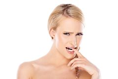 Bare Woman Biting her Finger in About to Cry Face Royalty Free Stock Photo
