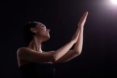 Bare woman look at light with yoga sign Royalty Free Stock Photography