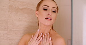 Bare Woman Taking a Shower with Hands on Head stock footage