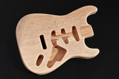 Bare wood or unfinished electric guitar body wood, with blank bo Stock Photo