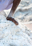 Bare worker foot salt in salt farm Stock Photos