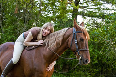 Bareback woman rider hugging her horse Royalty Free Stock Photo