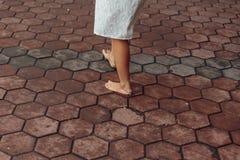 Bared foot woman walk around Batu Caves entrance near Kuala Lumpur, Malaysia. Bared foot woman walk around Batu Caves entrance near Kuala Lumpur, Malaysia Royalty Free Stock Image