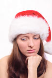 The bared girl in the red cap, looking downwards Royalty Free Stock Image