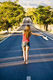 Barefeet balancing woman. Young barefeet woman balancing in the middle of the road Stock Photography