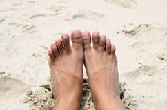 Barefeet on the beach. Barefeet relaxing on the beach Royalty Free Stock Photo