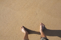Barefeet in sand. On beach in summer holidays relaxing Royalty Free Stock Image
