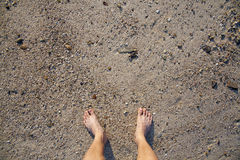 Barefeet in sand. On beach in summer holidays relaxing Royalty Free Stock Images