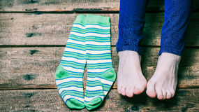 Barefeet and socks Royalty Free Stock Images