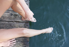 Barefeet in water Stock Images