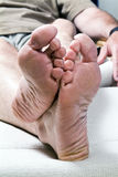 Barefoot. A picture of a man's feet whose tonails are in need of a good pedicure Royalty Free Stock Image