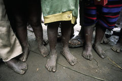 Barefoot african children. Poor African children waiting for food barefoot Royalty Free Stock Images