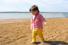 Barefoot baby boy walking on riverside Stock Photo