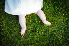 Barefoot baby girl on grass exploring Royalty Free Stock Photos
