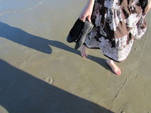 Barefoot on the beach Royalty Free Stock Photo