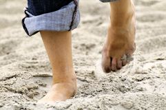 Barefoot on the beach Stock Photography