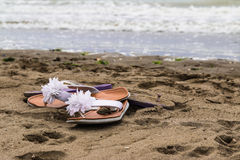 Barefoot Beach. Flip flops on the beach to walk barefoot Royalty Free Stock Photography