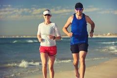 Barefoot beach run Stock Image