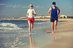 Barefoot beach run Stock Photos