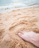 Barefoot on the beach Stock Photos