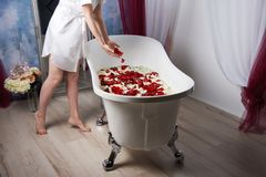 Barefoot beautiful girl getting ready to take a bath, spa concept royalty free stock photos