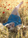 Barefoot blonde in poppies Stock Photo