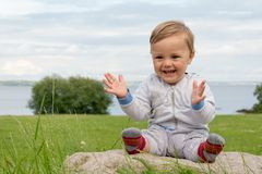 Barefoot boy crawling on the grass Stock Image