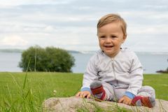 Barefoot boy crawling on the grass Royalty Free Stock Photography