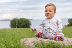 Barefoot boy crawling on the grass Royalty Free Stock Photos