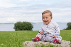 Barefoot boy crawling on the grass Royalty Free Stock Image