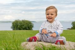 Barefoot boy crawling on the grass Royalty Free Stock Photo