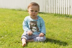 The barefoot boy rests on the grass stock photos