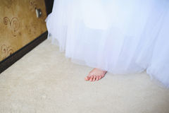 Barefoot Bride. In long wedding dress stock photography