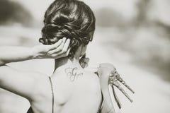 Barefoot brunette girl in black dress outdoor Royalty Free Stock Images