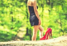 Barefoot brunette girl in black dress outdoor Stock Photography