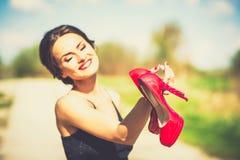 Barefoot brunette girl in black dress outdoor Royalty Free Stock Photo