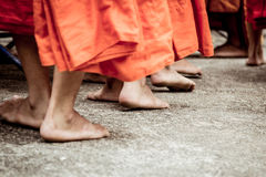 Barefoot of Buddhist monk while stand in a row Royalty Free Stock Image