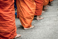 Barefoot of Buddhist monk while stand in a row Stock Images