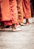 Barefoot of Buddhist monk while stand in a row Stock Image